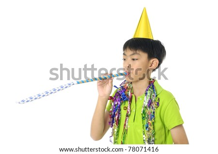 Boy l in cap playfully blowing noisemakers a birthday party - stock photo