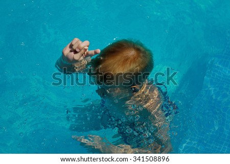 Boy learning diving in a pool. Summer, family holiday vacation concept #341508896