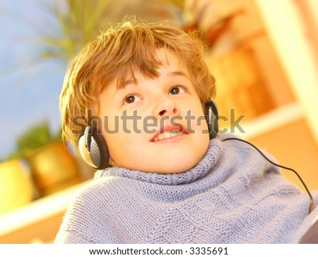 Boy listen to music in warm sunny bedroom - stock photo