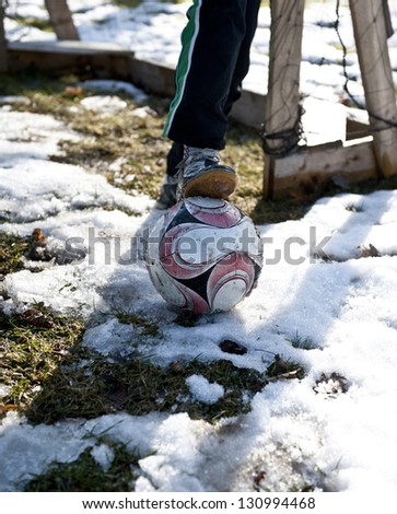 Boy longing for a game of soccer after a long winter break