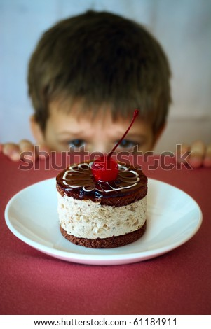 Boy longing to eat sweet cake