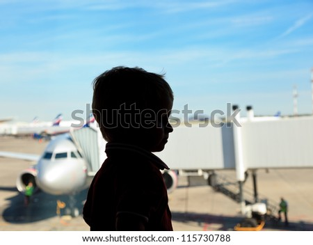 Boy looking at planes in the airport