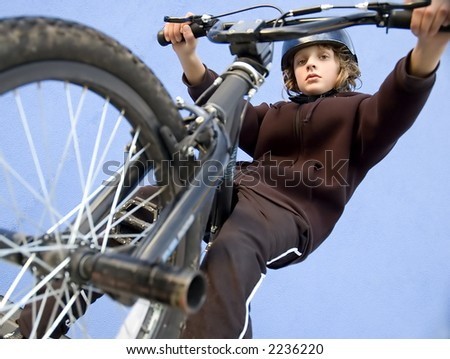 Boy looking down from BMX cycle