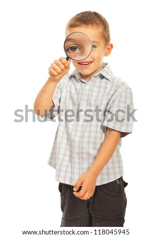 Boy looking through magnifier isolated on white background