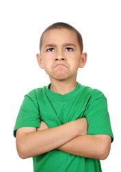 Boy looking up angry, isolated on white background