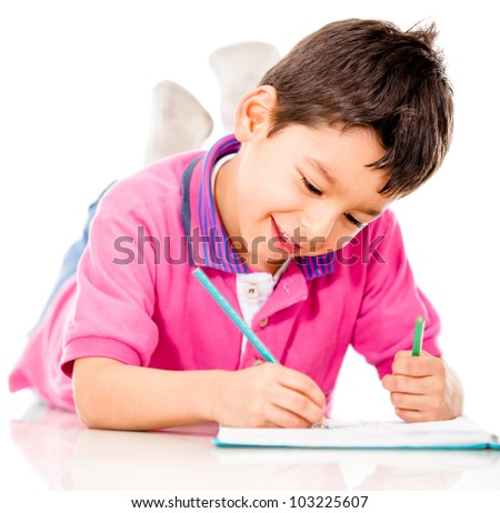 Boy lying on the floor coloring - isolated over a white background