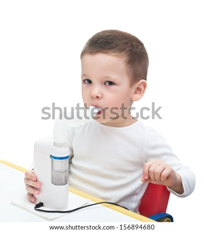 boy makes inhalation with ultrasonic nebuliser