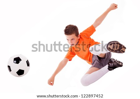 Boy making a acrobatic kick with soccer ball, isolated on white background.