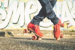 boy making cross position on roller skates