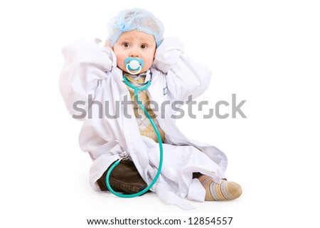 boy of one year old in gown of doctor with stethoscope