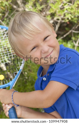 boy of 4 years old is with tennis racket