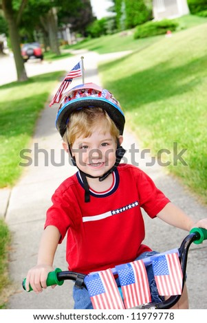Boy on a decorated bike on the 4th of July - stock photo