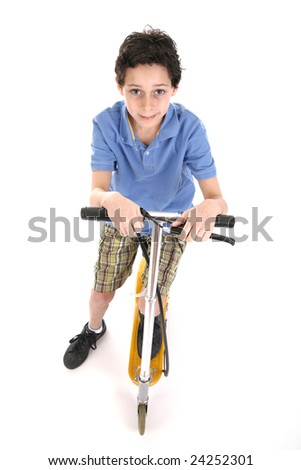 Boy on a scooter - isolated over the white background