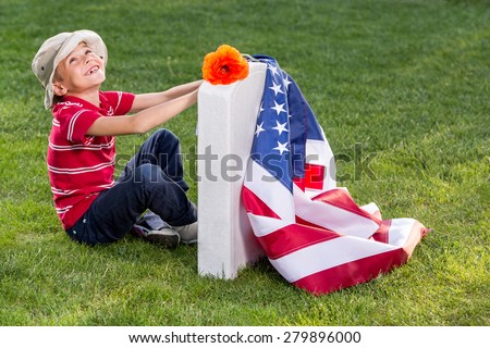 Boy on american cemetery. Memorial Day concept