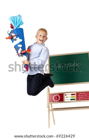 Boy on first school is happy and jumps in the air. Isolated on white background.
