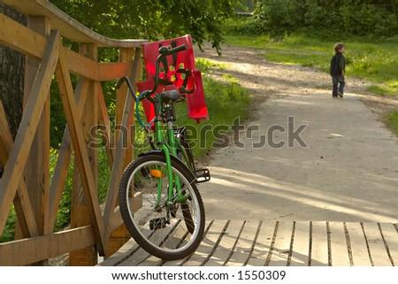 Boy on the bridge-cheerful walk along the river