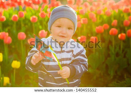 boy on the meadow with flowers