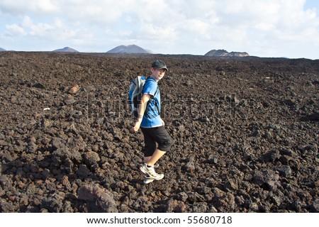 boy on walking trail thru volcanic area in Lanzarote #55680718