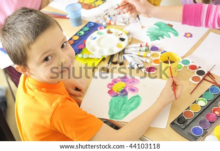boy painting with watercolor