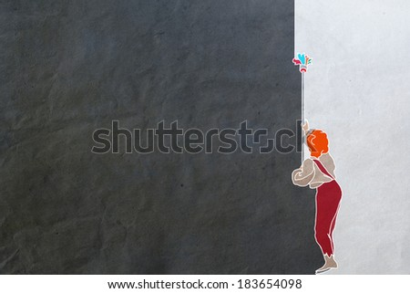 boy paints the wall, texture of paper, black and white. differences, changes, alteration,