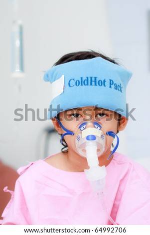 Boy patient in hospital and healing equipments