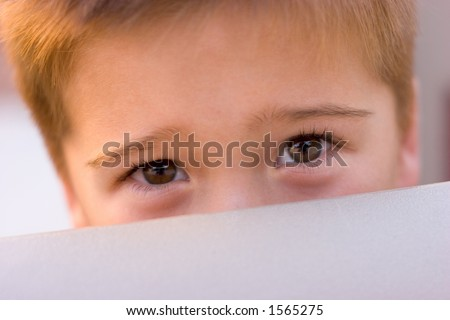 Boy Peeking Over the Side of a Playground