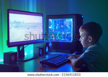 Boy play game on gaming PC online. #1536411833