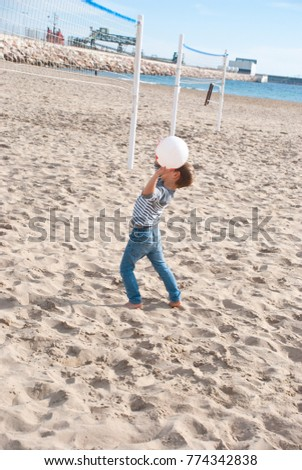 Boy play volleyball on beach. Active life. Activity in sunny day. #774342838