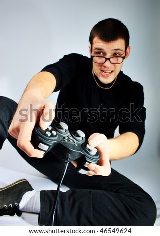 Boy playing a computer games - stock photo