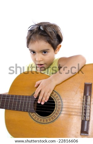 Boy playing a music with his guitar