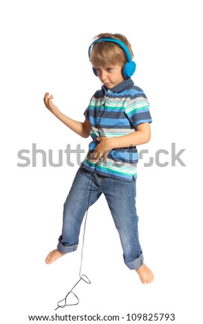 boy playing air guitar and dancing