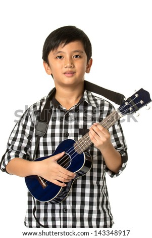 Boy playing guitar on white background.