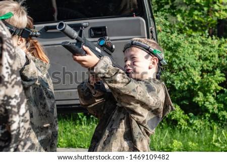 Boy playing in lasertag shooting game, boy with a gun, war simulation.