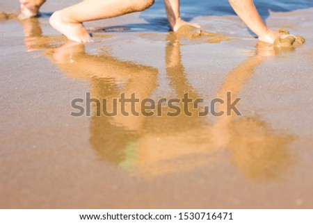 Boy playing in the sand on the beach Сток-фото ©