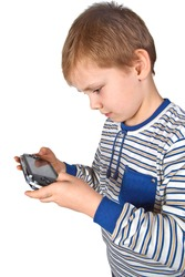 Boy playing portable video game isolated on white background