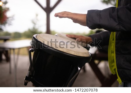 boy playing the drums, hands of man with drum