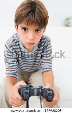 Boy playing video games on the couch