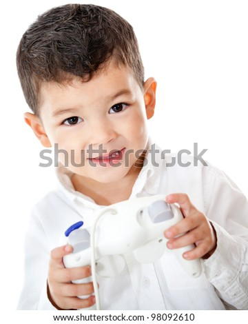 Boy playing videogames with a remote control - isolated over a white background