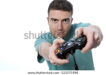 boy playing with a joypad isolated on white background