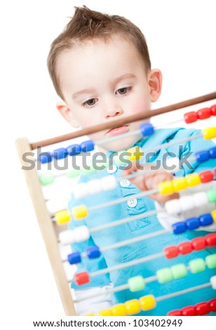 Boy playing with an abacus - isolated over a white background