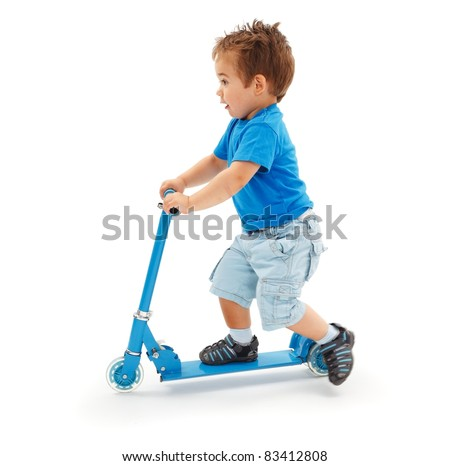 Boy playing with blue toy scooter (strong motion blur on leg)