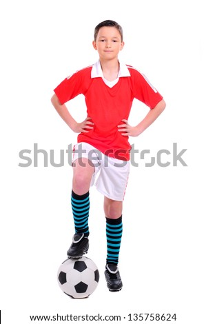 boy playing with football against white background