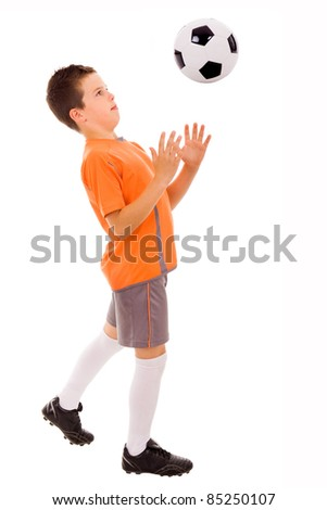 Boy playing with soccer ball against white background. ( focus on the head )