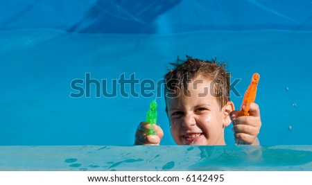 boy playing with squirt-guns