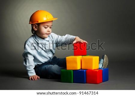 boy  plays with blocks