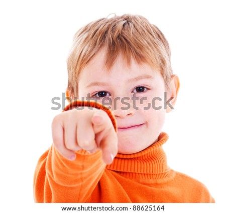boy pointing with finger against a white background