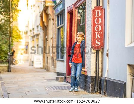 Boy portrait near bookshop in Cambridge, United Kingdom #1524780029