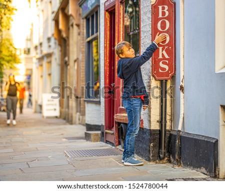 Boy portrait near bookshop in Cambridge, United Kingdom #1524780044