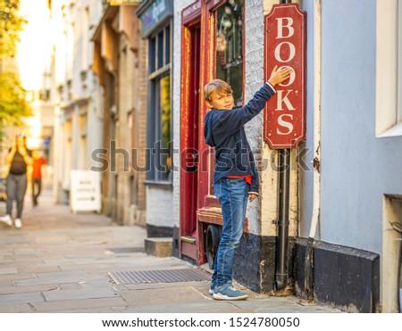 Boy portrait near bookshop in Cambridge, United Kingdom #1524780050