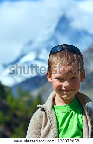 Boy portrait on summer Alps mountain plateau (Switzerland, Zermatt, Matterhorn)